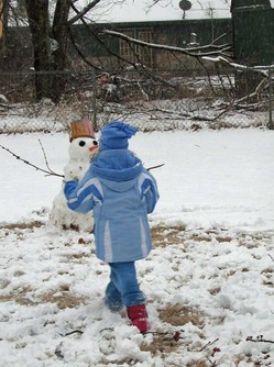 6_put_finishing_touches_on_snowman